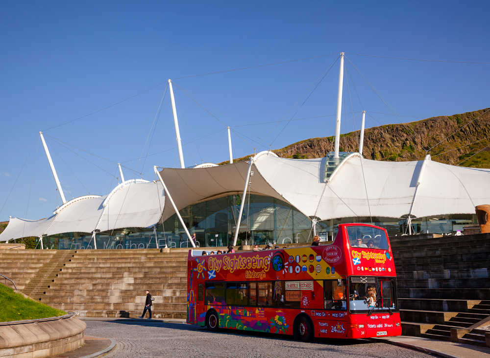 Red CitySightseeing Bus in front of Dynamic Earth, Edinburgh
