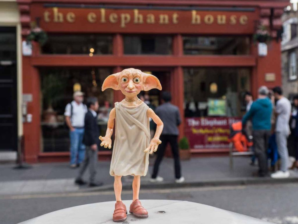 Dobbie in front of the Elephant House in Edinburgh