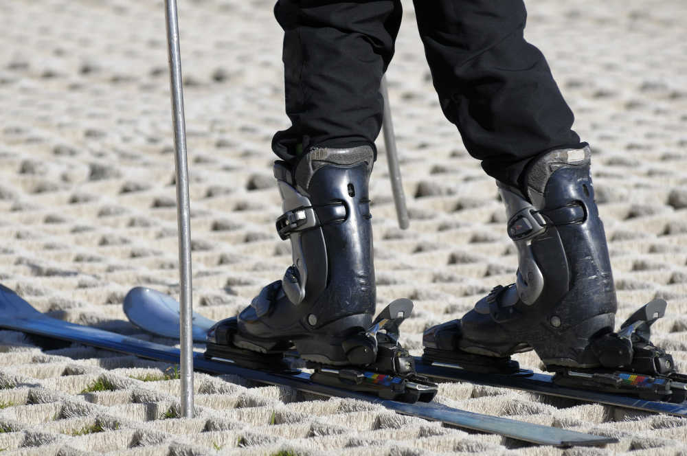 A skier on a dry ski slope.