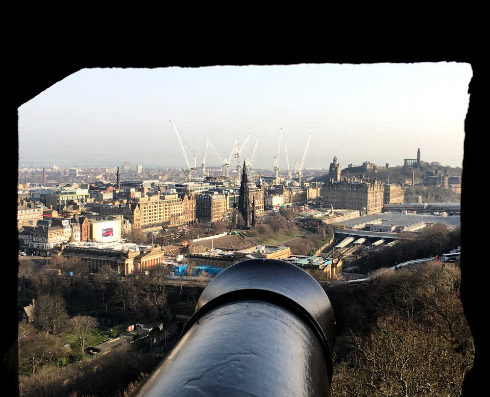 Canon + view towards Calton Hill from Edinburgh Castle